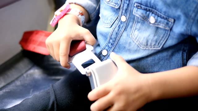 Girls is Fastening Seat belt on Airplane video