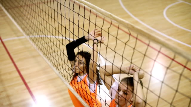 Girls jumping in block Women volleyball team training indoors, girls jumping in block. volleyball sport stock videos & royalty-free footage