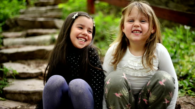 Girls looking at camera and smiling. Slow motion. video