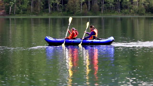 Girls paddling Kayak in lake video