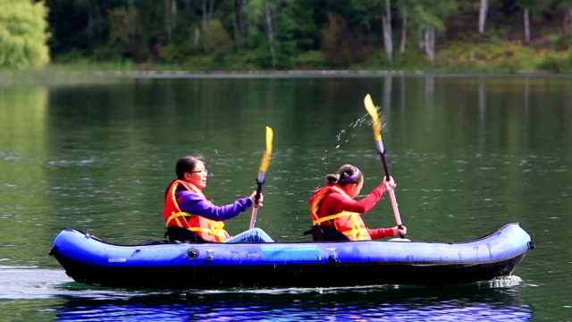 Girls paddling Kayak in lake video