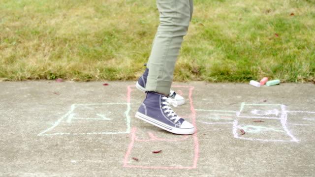 Girls Playing Hopscotch video