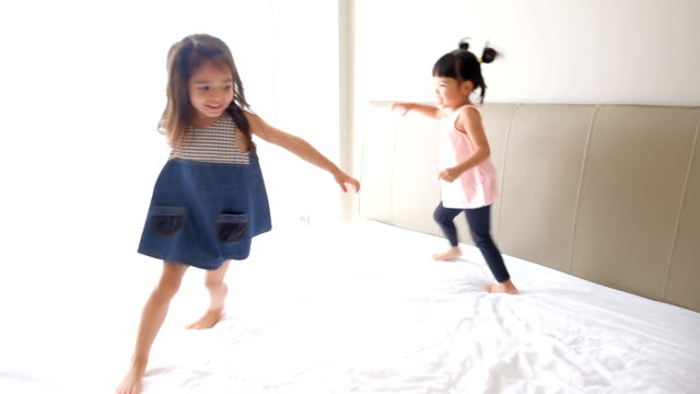 Girls Playing On The Bed video