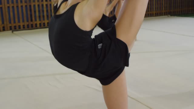 Girls Practicing Acro Dance Movements Sequence of videos of young teenage girls practicing acrobatic movements when having dance class dance studio stock videos & royalty-free footage