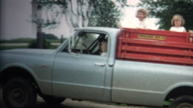 (8mm Vintage) 1966 Girls Riding Back Of Farm Truck in Iowa, USA.