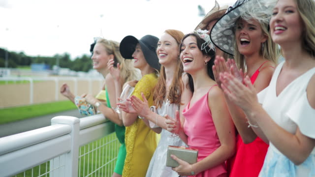 girls screaming for their horse on ladies day - cappello video stock e b–roll