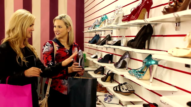 Girls shoe shopping / Browsing in the shop, store Stock HD video clip footage of 2 girls browsing the shoes in a shoe shop dress shoe stock videos & royalty-free footage