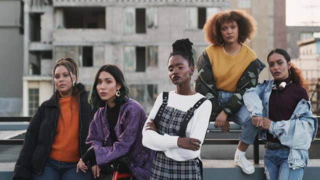 Girls that stick together rule together 4k video footage of a diverse group of friends posing together while being on the rooftop during the day group of people stock videos & royalty-free footage