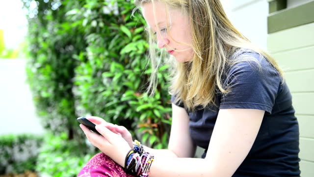 Girls using mobile device video
