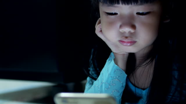 Girls using smartphone at night baby girl using mobile phone at night family watching tv stock videos & royalty-free footage
