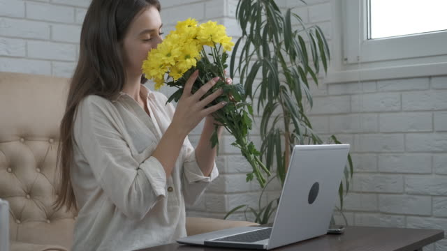 give flowers at work. - nazionalità russa video stock e b–roll