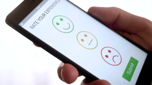 Giving a positive feedback on customer satisfaction app using smartphone Giving a positive feedback on customer satisfaction app using smartphone stock footage satisfaction stock videos & royalty-free footage
