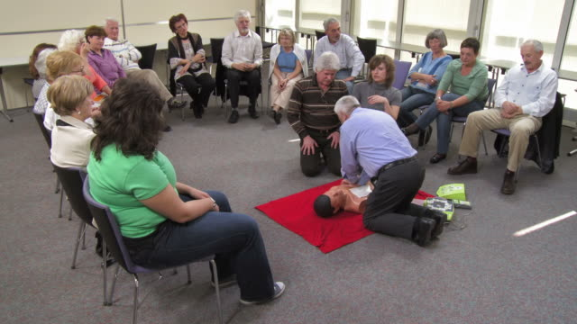 HD: Giving Applause After Demonstrating CPR On A Dummy