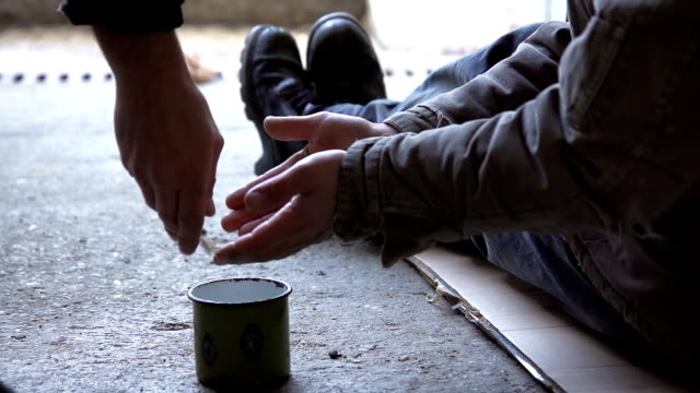 hd slow-motion: giving change to a begging homeless - homelessness stock videos & royalty-free footage