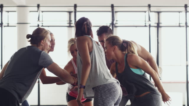 Giving each other that extra push 4k video of a group of people celebrating after a workout at the gym health club stock videos & royalty-free footage