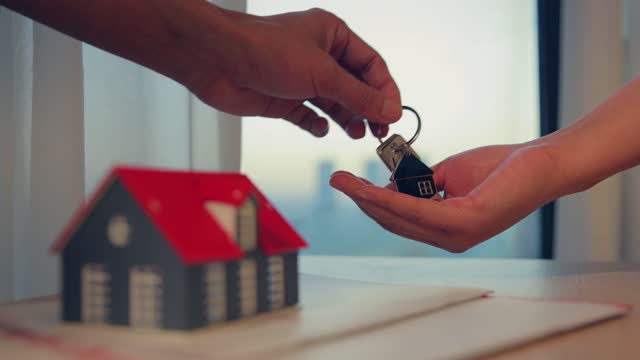 Giving key to new homeowners