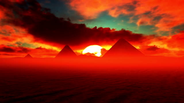 giza pyramids with red dark clouds running over - египет стоковые видео и кадры b-roll