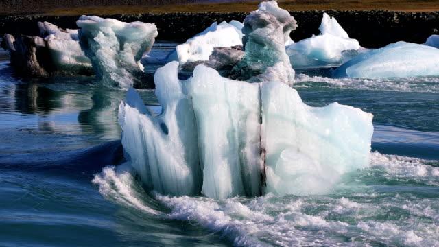 Glacial lake Jokulsarlon in Iceland Floating icebergs in the glacial lake Jokulsarlon in Iceland icecap stock videos & royalty-free footage
