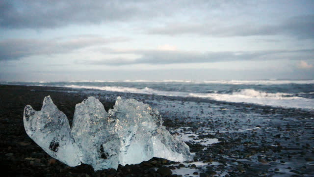 Glacier Ice on Black Sand Diamond Beach in Jokulsarlon Iceland video