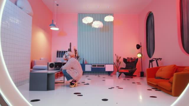 Glamorous Woman Dancing Vogue for Camera in Retro Studio