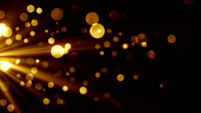 Glamour abstract background for celebration with stream of golden particles and shiny dust. Seamless loop.