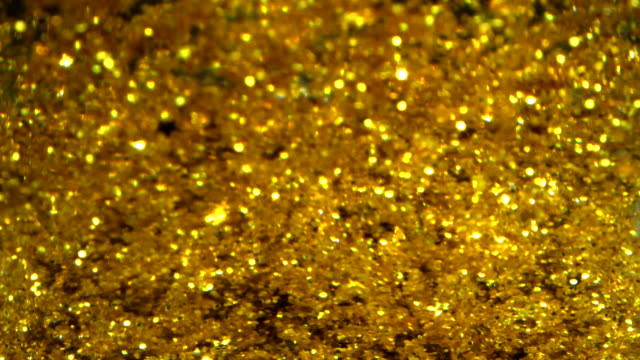 glamourous ışıltılı akmak altın arka plan - altın metal stok videoları ve detay görüntü çekimi