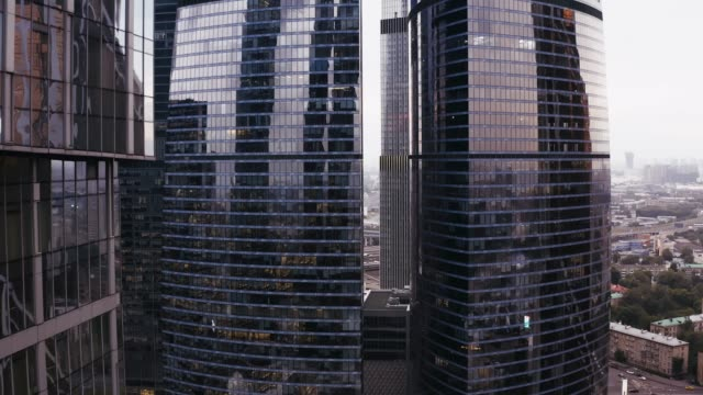 Glass and concrete skyscrapers, business centers. aerial flight.