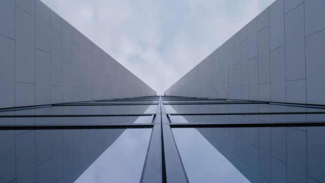 Glass and Concrete Structure Abstract with Vanishing Point in Sky Glass and concrete structure abstract with vanishing point in sky. Low angle view. low angle view stock videos & royalty-free footage