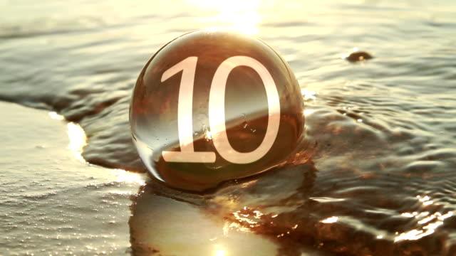 Glass ball at seashore, countdown video