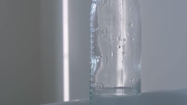 Glass bottle with water and teat in maternity hospital video