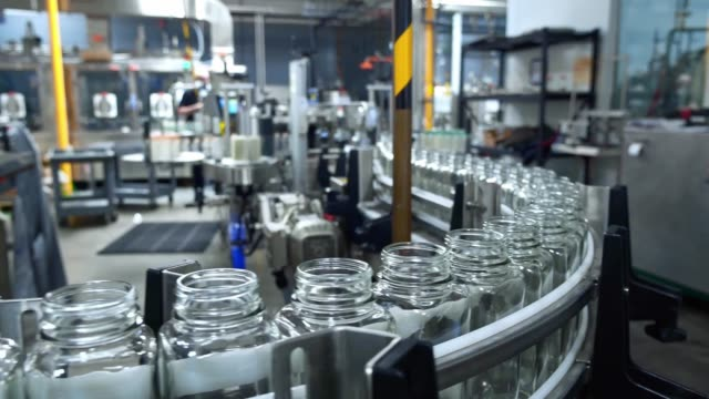glass bottles on the conveyor belt. - agricultural machinery stock videos & royalty-free footage
