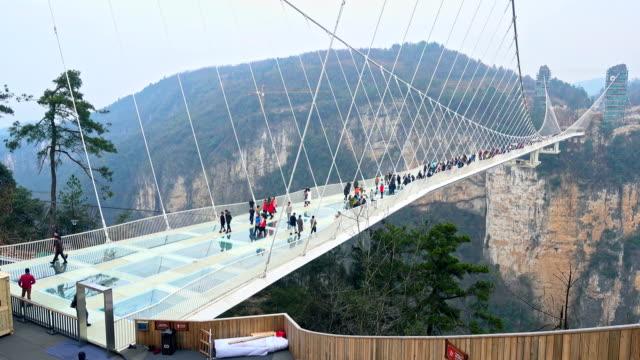 Glass bridge of Zhangjiajie China Glass bridge of Zhangjiajie China suspension bridge stock videos & royalty-free footage