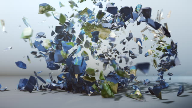 Glass earth globe explosion - slow motion video