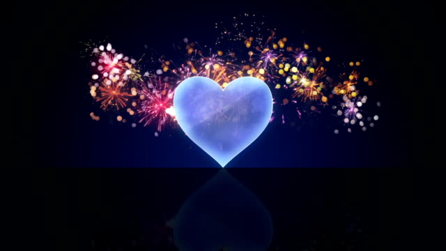 glass heart shape and fireworks loop animation video