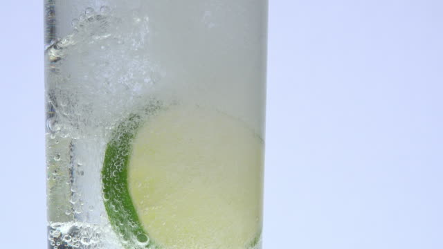 glass, ice, lemon and tonic closeup with white background tonic water stock videos & royalty-free footage