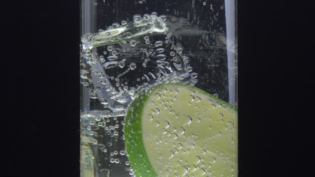 glass, ice, lemon and tonic closeup with black background tonic water stock videos & royalty-free footage