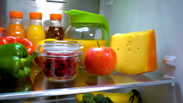 Glass jar of fresh raspberries in a refrigerator Products in the refrigerator. Glass jar of fresh raspberries in a refrigerator fridge stock videos & royalty-free footage