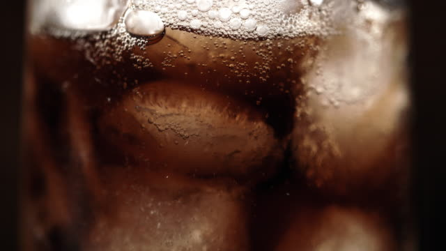 SLO MO CU Glass of a soft drink with ice Super slow motion close up shot of a glass of a cold soft drink with ice. thirsty stock videos & royalty-free footage