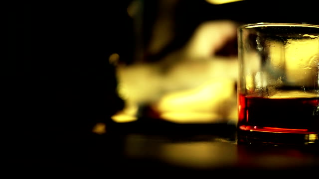 Glass of alcohol.Close up video