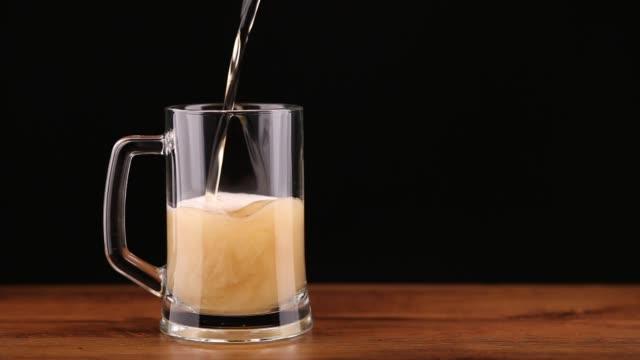 glass of beer (studio lighting) - oktoberfest stock videos and b-roll footage