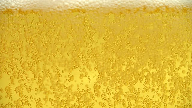 Glass of beer with bubbles. video