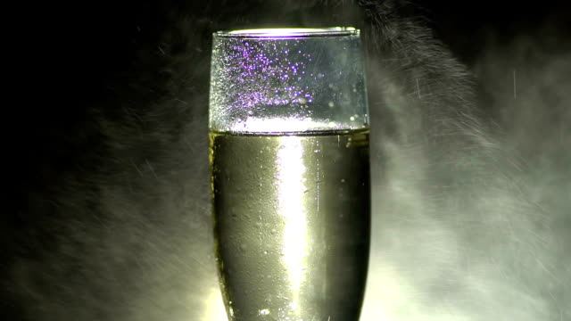 Glass of champagne with falling water drops. video
