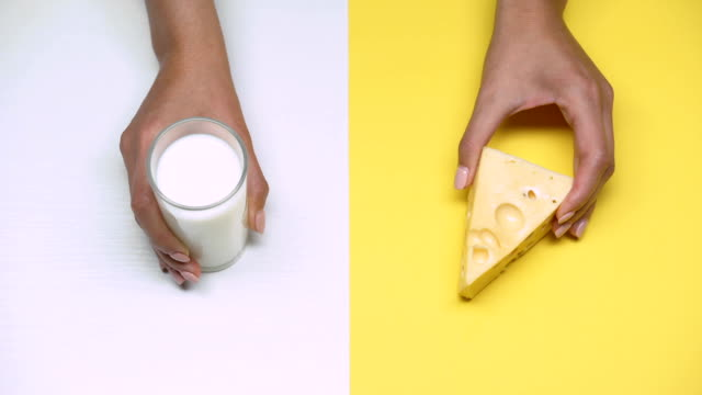 Glass of milk and cheese, dairy products rich in calcium, lactose intolerance Glass of milk and cheese, dairy products rich in calcium, lactose intolerance cheese stock videos & royalty-free footage