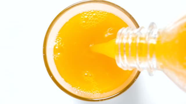 Glass of orange juice top view.