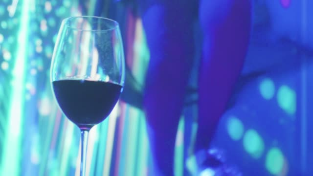 Glass of red wine At Dance Music Party video