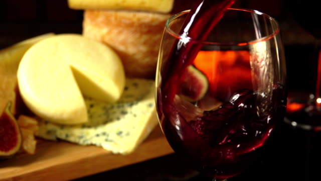 glass of red wine on a background of cheese plate - fine dining stock videos and b-roll footage