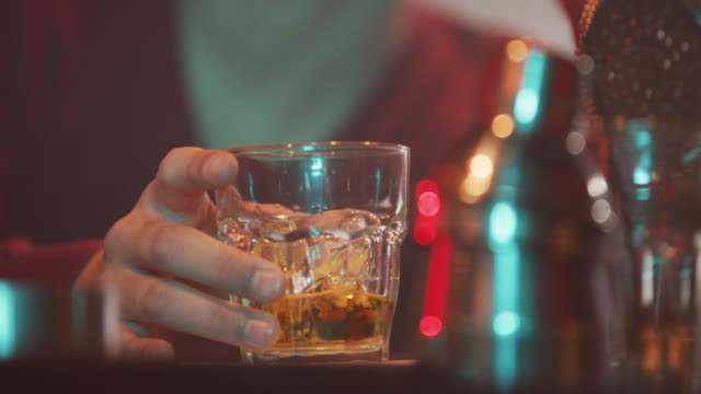 Glass of whiskey on the bar counter 4K video