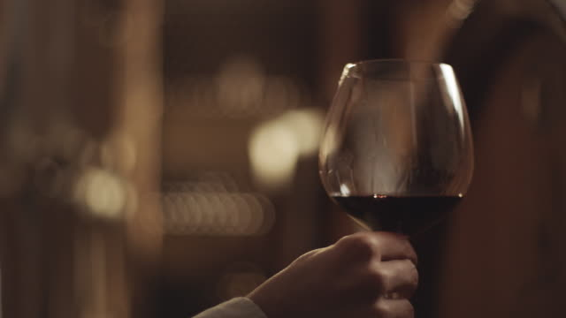 Glass of white wine in wine cellar