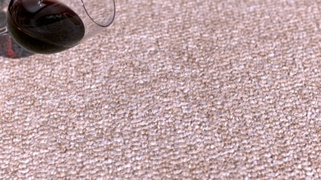 Glass of wine spilling on carpet video