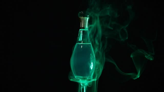 glass perfume bottle smoke hd footage - profumato video stock e b–roll